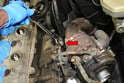 Use a 19mm wrench and disconnect the oil line from the balance shaft to turbo (red arrow).