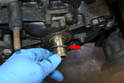 With the Woodruff key gone you can remove the washer that covers the gear and O-ring (red arrow).