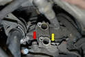 There are two bolts on the mount that you will use to adjust the height of the sensor from the flywheel.