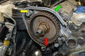 With the timing belt removed the cam sprocket should be set at Top Dead Center (green arrow).