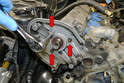 Use a 10mm socket and remove the three bolts located behind the sprocket (red arrows).