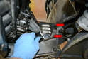 On the right side you will need to use a 10mm wrench and remove the shield (red arrows).