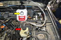 Next, fill the Motive Power Bleeder with two quarts of brake fluid, if you are flushing the system.