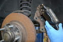 Remove the caliper from the spindle and rotor.