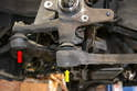 The spindle is connected to the tie rod (red arrow) and the control arm ball joint (yellow arrow).