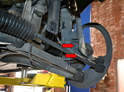 The bolts are located behind an air diverter for the brakes (red arrows).