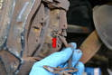 With the pistons back you can slide the brake pads out from the caliper.