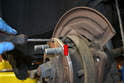 This photo illustrates the small cogwheel inside the rotor that you will be turning (red arrow).