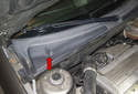 The cabin filter is located below the right side wiper cowl (red arrow).