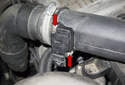 Working at the mass air flow sensor, remove the two T20 Torx screws (red arrows).