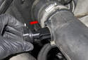 Remove the sensor from the intake air housing lid (red arrow).