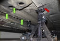 Jacking front of vehicle: When jacking the front of the vehicle, block the rear wheels.