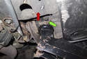 Jacking rear of vehicle: This photo shows the jack in place, lifting the vehicle using the rear suspension to body connection (green arrow).