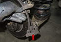 Remove the brake caliper bracket (red arrow).
