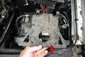 Separate the fuse panel from the plastic mount (red arrow) it sits on and tie it back up out of the way.