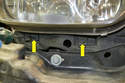 This photo illustrates the two T25 Torx screws located below the lens (yellow arrows).
