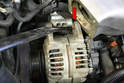 There is going to be a very good chance you will need a pry bar to remove the alternator from its bracket (red arrow).