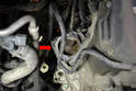 Clean the mounting area (red arrow) and inspect the starter ring teeth for damage.