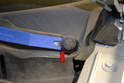 Use a trim removal tool and remove the protective cap (red arrow).