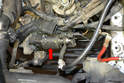 Remove the starter motor (red arrow).