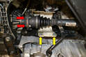 Working under the right side of the car remove the six 12 point 12mm bolts between the axle and flange (red arrow, two shown) You do not need to remove the heat shield for the turbo (yellow arrows) but it will give you more room to work.