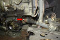 Remove the six bolts from the left side axle to flange (red arrow, one shown) and tie the axle up out of the way.