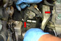 Remove the cross brace from the transmission mount to the transmission (red arrows).