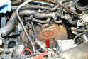 With the transmission removed and the engine safely supported you now have access to the clutch (red arrow).
