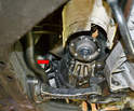 The speedometer sensor is located on the top right side of the differential housing (red arrow).