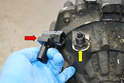 Unplug the sensor (red arrow) from the wiring harness and unscrew from the pinion shaft (yellow arrow).