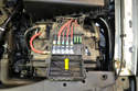 This fuse box contains high current fuses for heavy load applications like the engine management and charging systems (yellow arrow).