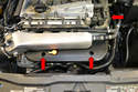 The forward cover is held in place by the same type of screws (red arrows).