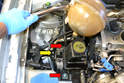 Remove the 13mm bolt (yellow arrow) and two 16mm bolts (red arrows) on the mount under the steering fluid reservoir.