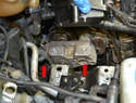 Use a 16mm socket and remove the three bolts (red arrows, two shown) that attach the mount to the engine.