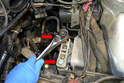 Use you 18mm socket and remove the two bolts (red arrows) holding the mount to the engine/transmission support.