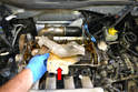 Move back to the top of the engine and remove the upper turbo heat insulation from the outlet pipe (red arrow).