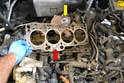 Remove the old gasket (red arrow) from both the block and the turbo charger (yellow arrow).