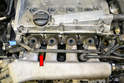 Unplug the knock sensor on the engine block below the number 1 and 2 intake runners (red arrow).