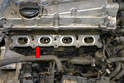 Lift the intake manifold off the two lower studs and remove it from the engine.