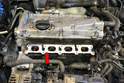 Carefully clean the intake port mounting area (red arrow), install a new gasket and put everything back together.