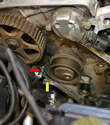 After you have removed the belt you are left with the tensioner with the piston compressed (red and yellow arrows).