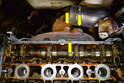 Working at the rear of the engine remove the three 17mm bolts (yellow arrows) holding the turbo to the exhaust manifold.