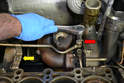 Disconnect the upper coolant line from the turbo (red arrow) along with where the line mounts to the engine (yellow arrow).