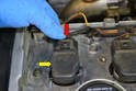 While you can remove the coils without removing the wiring harness it is easy to disconnect the harness from the coils and it will give you a lot more room to work.