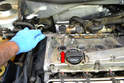 Use your 5/8 thin walled spark plug socket along with a long extension and remove the plugs (red arrow).