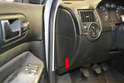 Open the left side door and on the side of the dash that you will see a panel (red arrow).