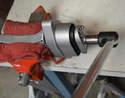 Next place the mount in a vice and use a 16mm socket to undo the mount.