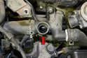 The housing (red arrow) can get road grime in it so make sure you take care not to get any into the pipe and give it a good cleaning before installing the new sensor and gasket.