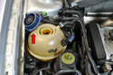 Open the fluid reservoir (red arrow) to assist in draining.
