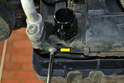 Next remove the T30 Torx screw (yellow arrow) holding the A/C bracket to the radiator.